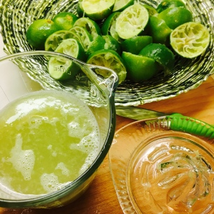 squeezing limes for a proper bajan rum punch